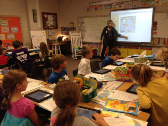Media specialist Mrs. Provano using the smartboard and iPads for her lesson in Ms. Murray's classroom.
